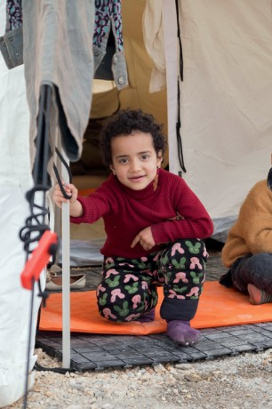 A refugee boy at Schisto Camp in Athens