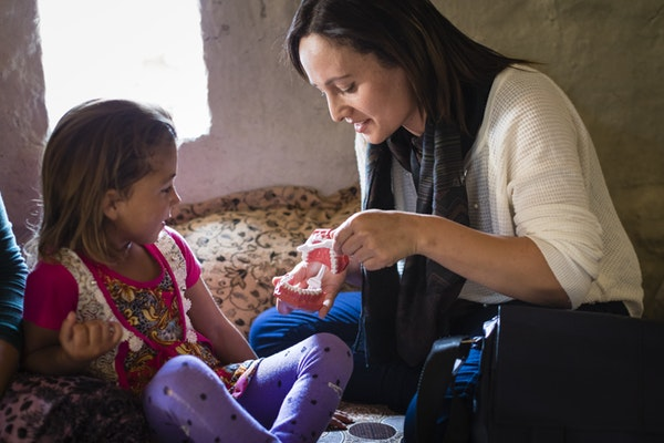 Samaritan's Purse sends health promotion teams into the camp to teach families about proper hygiene methods like brushing your teeth.